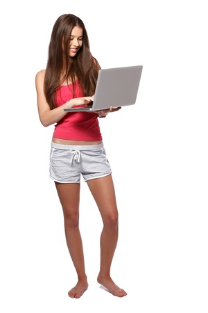 nice young lady using laptop in studio photo