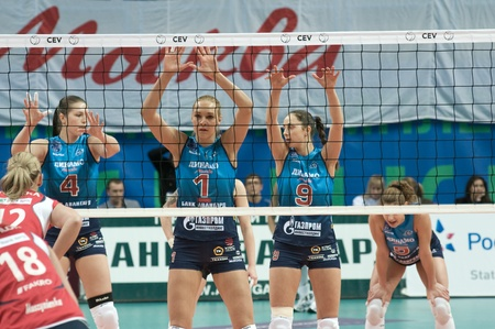 MOSCOW, RUSSIA - DECEMBER 8: Unidentified players in action a European League womans volleyball game Dynamo Russia (blue) vs Bank BPS Mushin Poland (red) on December 8, 2011 in Moscow, Russia.