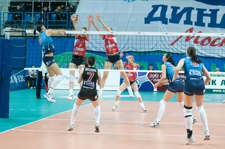 MOSCOW, RUSSIA - DECEMBER 8: Unidentified players in action a European League womans volleyball game Dynamo Russia (blue) vs Bank BPS Mushin Poland (red) on December 8, 2011 in Moscow, Russia. Editorial