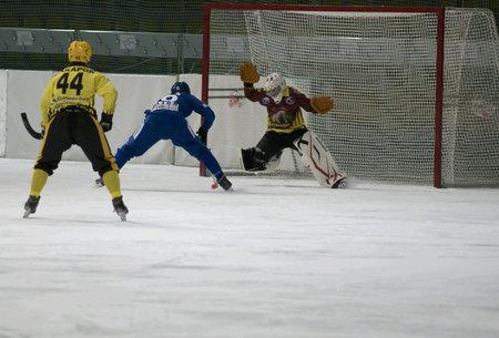 MOSCOW - FEBRUARY 22  Hockey match Dynamo  blue  - Moorman  yellow  in ice sports palace Krylatskoye on February 22, 2012 in Moscow, Russia  Dynamo won 11 - 3