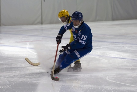 MOSCOW - FEBRUARY 22  Hockey match Dynamo  blue  - Moorman  yellow  in ice sports palace Krylatskoye on February 22, 2012 in Moscow, Russia  Dynamo won 11 - 3  Editorial