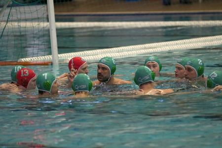 waterpolo: MOSCOW - APRIL 6: Players of Sintez Kazan team just before a game Dynamo-CST Moscow (white) vs Sintez Kazan (green) of waterpolo Championship of Russia on April 6, 2012 Moscow, Russia. Sintez won 11:10