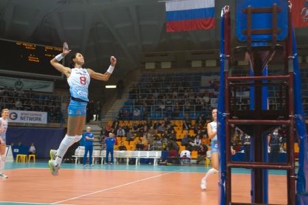 MOSCOW, RUSSIA - FEBRUARY 18: Natalie Obmochaeva srikes the ball ia Russian Championship woman's volleyball game Dinamo Russia (white) vs Omichka (black) Omsk on February 18, 2013 in Moscow, Russia Stock Photo - 18113561