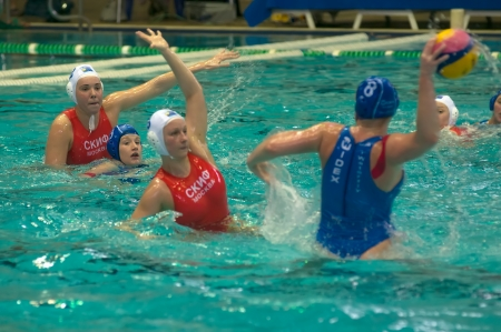 polo player: MOSCOW - MARCH 23: Unidentified players in action semifinal LEN Trophy at a water-polo game between SKIF CSP