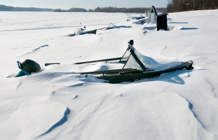 wintering: Hibernating under the snow with a motor boat