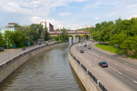 View from the bridge on Kostomarovsky Yauza and Andronicus viaduct photo