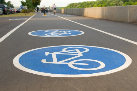 Bicycle road sign on asphalt. Leisure activities photo
