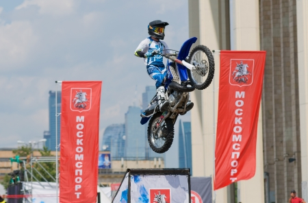 RUSSIA, MOSCOW-JULY 13: motofristayler Anton Smirnov at the sports festival Moscow City Games 2013 in the program Moto Freestyle (FMX) in Moscow, Arena Luzhniki�; on July 13, 2013