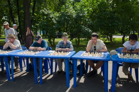 decs: RUSSIA, MOSCOW-JULY 13: Several unidentified players odnovrmenno play chess at the sports festival Moscow City Games 2013 in Moscow, Arena Luzhniki�; on July 13, 2013