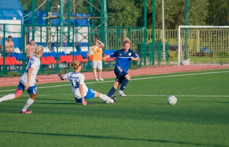 MOSCOW - AUGUST 18 Unidentified players in action on game Kubanochka vs CSP Izmailovo on Russian tournament of wemen football league on August 18, 2013, in Moscow, Russia