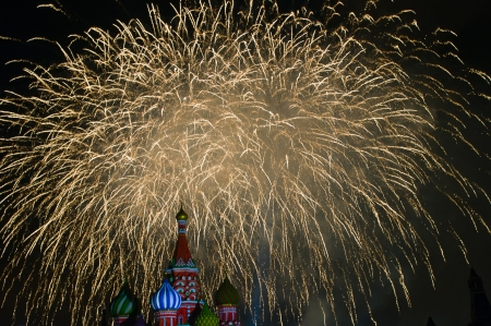 Fireworks explode over St  Basil Cathedral at night in Red Square in Moscow, Russia  photo