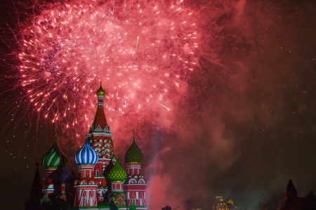 Fireworks explode over St  Basil Cathedral at night in Red Square in Moscow, Russia