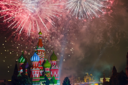 Fireworks explode over St  Basil Cathedral at night in Red Square in Moscow, Russia Reklamní fotografie - 24087399