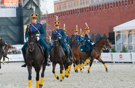 cossack parade: MOSCOW - SEPTEMBER 9: The Honor Cavalry Escort presentation on International Military Music Festival Spasskaya Tower on September 9, 2013 in Moscow. Editorial