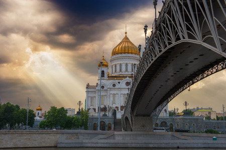 Ray of sunshine breaks through the clouds and shines on the Cathedral of Christ the Savior. Moscow. Russia. photo