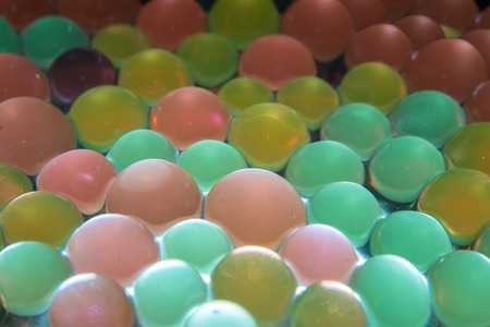 Background with transparent colored beads closeup photo