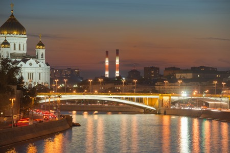 Moskva River, Big Stone Bridge and Cathedral of Christ the Saviour at night in the light of the city lights photo