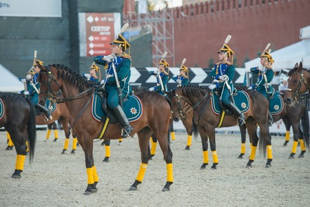 spasskaya: MOSCOW, RUSSIA - SEPTEMBER 7.  Riders of cavalry honorary escort of Presidential Regiment at Military Music Festival Spasskaya Tower in Red Square in Moscow on September 7, 2014.