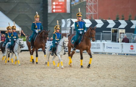cossack parade: MOSCOW, RUSSIA - SEPTEMBER 7. Riders of cavalry honorary escort of Presidential Regiment and Kremlevskaya riding school at Military Music Festival Spasskaya Tower in Red Square in Moscow on September 7, 2014.