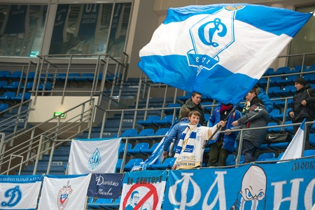 maccabi: MOSCOW  DECEMBER 4, 2014:  Unrecognized fans of the club Dynamo on the International Europe bascketball league match Dynamo Moscow vs Maccabi Ashdod Israel in sport palace Krilatskoe, Moscow, Russia. Dynamo loss 59:67 Editorial