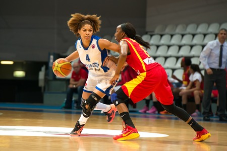 ashdod: MOSCOW  DECEMBER 4, 2014: Katerina Keyru (4) dribble on the International Europe bascketball league match Dynamo Moscow vs Maccabi Ashdod Israel in sport palace Krilatskoe, Moscow, Russia. Dynamo loss 59:67 Editorial