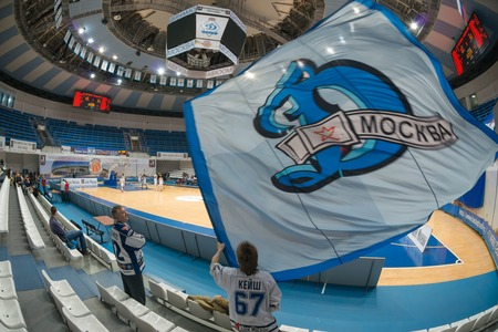 dynamo: MOSCOW  DECEMBER 4, 2014:  Unrecognized fans of the club Dynamo on the International Europe bascketball league match Dynamo Moscow vs Maccabi Ashdod Israel in sport palace Krilatskoe, Moscow, Russia. Dynamo loss 59:67 Editorial