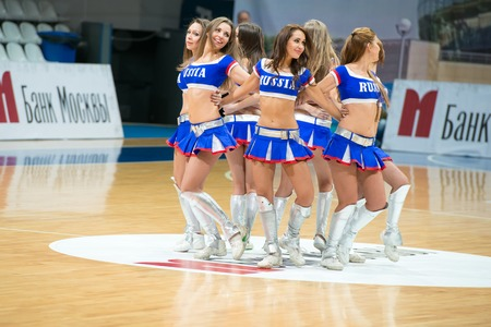 maccabi: MOSCOW DECEMBER 4, 2014: Unidentified cheerleaders dans on the International Europe bascketball league match Dynamo Moscow vs Maccabi Ashdod Israel in sport palace Krilatskoe, Moscow, Russia. Dynamo loss 59:67