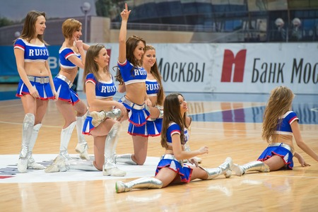 ashdod: MOSCOW  DECEMBER 4, 2014: Unidentified cheerleaders dans on the International Europe bascketball league match Dynamo Moscow vs Maccabi Ashdod Israel in sport palace Krilatskoe, Moscow, Russia. Dynamo loss 59:67 Editorial