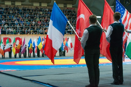 sambo: RUSSIA, MOSCOW - MARCH 27: Stadium Druzhba. A solemn parade of flags of participating countries of the World Cup Memorial A. Kharlampiev by pupils of the school Sambo 70 in Luzhniki sport palace, Moscow, Russia, 2015
