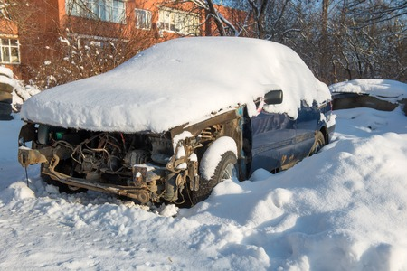 Broken and shattered car is worth in the snow photo