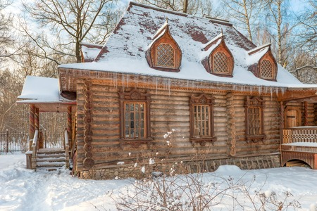 old barn in winter: Wooden house in the old style in a snowy forest Editorial