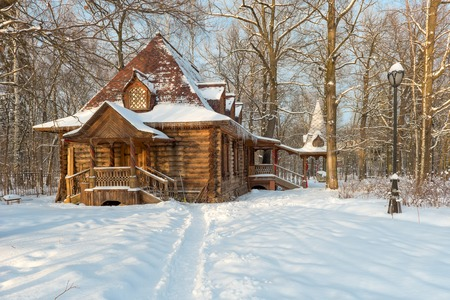 dacha: Wooden house in the old style in a snowy forest Editorial
