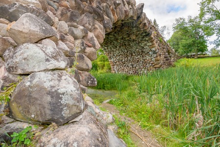 consisting: Hundred-meter boulder-arch bridge with two grotto - aviary, called by locals Devils Bridge. Consisting of dry stacked boulders, kept only by gravity