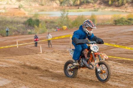 mini bike: MOSCOW-OCTOBER 10: Race winner Igor Eremeev 57 (Zelenograd), class 50 cc, in the 5 stage of the XSR-MOTO.RU Cross Country in Moscow, Park Velyaminovo; on October 10, 2015 Editorial