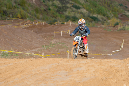 mini bike: MOSCOW-OCTOBER 10: Andrey Kiselev 99 (Zelenograd), class 50 cc, in the 5 stage of the XSR-MOTO.RU Cross Country in Moscow, Park Velyaminovo; on October 10, 2015 Editorial