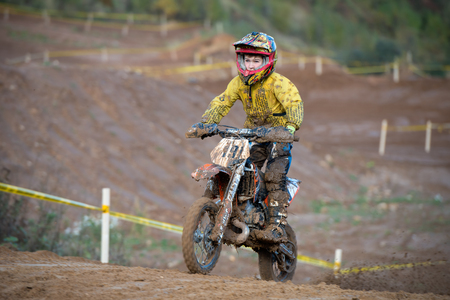 seraphim: MOSCOW-OCTOBER 10: Sukhotin Seraphim 19 (Moscow), class Country Kidz, in the 5 stage of the XSR-MOTO.RU Cross Country in Moscow, Park Velyaminovo; on October 10, 2015 Editorial