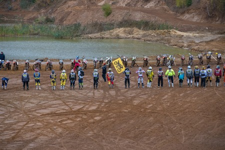 super cross: MOSCOW-OCTOBER 10: The judge gives the start of the race, class Moto, in the 5 stage of the XSR-MOTO.RU Cross Country in Moscow, Park Velyaminovo; on October 10, 2015