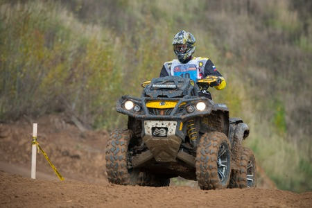 supercross: MOSCOW-OCTOBER 10: Alexander Kuzmin 19 (Quad Boom), class 4x4, in the 5 stage of the XSR-MOTO.RU Cross Country in Moscow, Park Velyaminovo; on October 10, 2015 Editorial