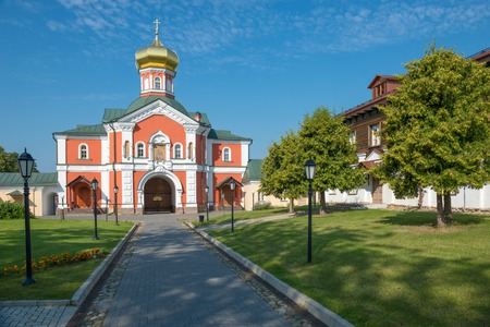 narrowing: The Valdai Iver Svyatoozersky Virgin Monastery. Gate Church of St Philip, Metropolitan of Moscow and All Russia in 1879 Stock Photo
