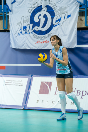 women's volleyball game: MOSCOW, RUSSIA - DECEMBER 2: Irina Malkov (Dynamo (KZN) 5, while playing on womens Rissian volleyball Championship game Dynamo (MSC) vs Dynamo (KZN) at the Luzhniki stadium in Moscow, Russia. Kazan won in serie 3: 2