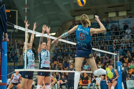 women's volleyball game: MOSCOW, RUSSIA - DECEMBER 2: Anastasia Markova (Dynamo (MSC) 5 while playing on womens Rissian volleyball Championship game Dynamo (MSC) vs Dynamo (KZN) at the Luzhniki stadium in Moscow, Russia. Kazan won in serie 3: 2