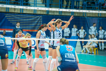 women's volleyball game: MOSCOW, RUSSIA - DECEMBER 2: Unidentified players in action during the game on womens Rissian volleyball Championship game Dynamo (MSC) vs Dynamo (KZN) at the Luzhniki stadium in Moscow, Russia. Kazan won in serie 3: 2