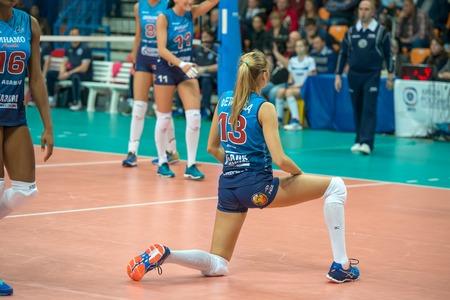 women's volleyball game: MOSCOW, RUSSIA - DECEMBER 2: Irina Fetisov (Dynamo (MSC) 13, while playing on womens Rissian volleyball Championship game Dynamo (MSC) vs Dynamo (KZN) at the Luzhniki stadium in Moscow, Russia. Kazan won in serie 3: 2
