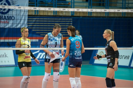 women's volleyball game: MOSCOW, RUSSIA - DECEMBER 2: Greeting the team captains before the game on womens Rissian volleyball Championship game Dynamo (MSC) vs Dynamo (KZN) at the Luzhniki stadium in Moscow, Russia. Kazan won in serie 3: 2 Editorial