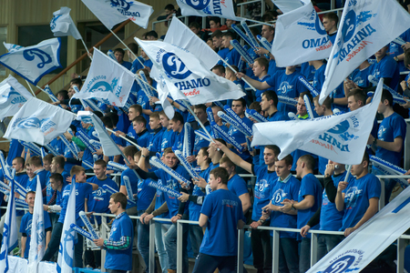 women's volleyball game: MOSCOW, RUSSIA - DECEMBER 2: Fans of Dynamo Moscow during the game on womens Rissian volleyball Championship game Dynamo (MSC) vs Dynamo (KZN) at the Luzhniki stadium in Moscow, Russia. Kazan won in serie 3: 2 Editorial