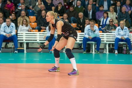 women's volleyball game: MOSCOW, RUSSIA - DECEMBER 2: Anna Malova (Dynamo (MSC) 3 while playing on womens Rissian volleyball Championship game Dynamo (MSC) vs Dynamo (KZN) at the Luzhniki stadium in Moscow, Russia. Kazan won in serie 3: 2