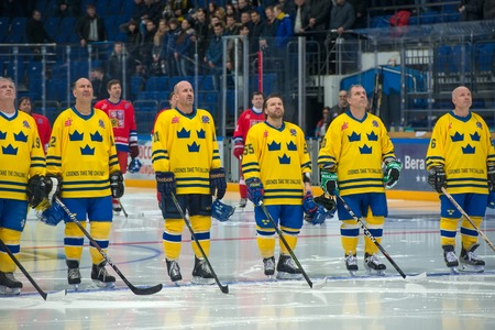 legends: MOSCOW - JANUARY 29, 2016: Player listening to national anthems on hockey game Sweden vs Czech Republic on World Legends hockey league on January 29, 2015, in Moscow, Russia.