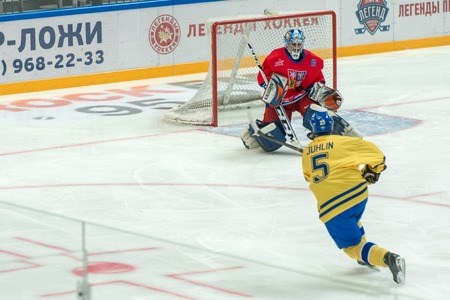 legends: MOSCOW - JANUARY 29, 2016: Goalkeeper Czech Republic Marcel Kucera (1) on hockey game Sweden vs Czech Republic on World Legends hockey league on January 29, 2015, in Moscow, Russia.