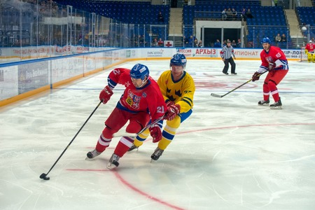 honored: MOSCOW - JANUARY 29, 2016: Czech Republic team forward Jan Peterek (21) on hockey game Sweden vs Czech Republic on World Legends hockey league on January 29, 2015, in Moscow, Russia. Editorial