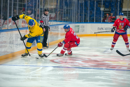 honored: MOSCOW - JANUARY 29, 2016: Magnus Roupe (19) and Jan Peterek (21) on hockey game Sweden vs Czech Republic on World Legends hockey league on January 29, 2015, in Moscow, Russia.